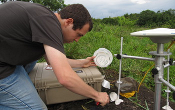 rsearcher with instruments in the field