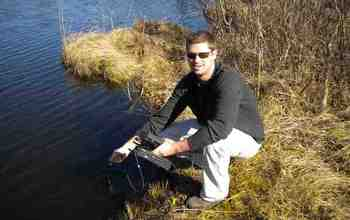 Scientist Ryan Batt obtains readings of oxygen levels in a lake in northern Wisconsin.