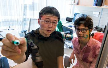 Feng Zhang in his laboratory with graduate student Patrick Hsu.