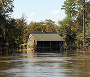 Floodwaters around a house.