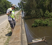 Scientist taking samples of flooded rivers.