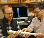 Researchers examine a coral core