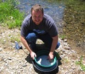 Biogeochemist Keith Morrison sieves antibacterial blue clay in the Oregon Cascades.