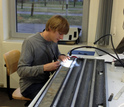 Geochemist Gabe Bowen working on a sediment core in the lab.
