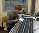 Geochemist Gabe Bowen working on a sediment core in the lab.
