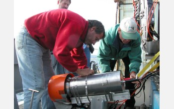 Scienitsts prepare the high-definition TV camera for loading onto a remotely operated vehicle.