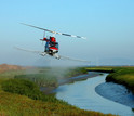 Helicopter spraying herbicide to eradicate invasive Spartina in San Francisco Bay.
