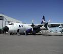 C-130 aircraft by hangar