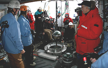 Group of scientist near the end of the construction of IceCube