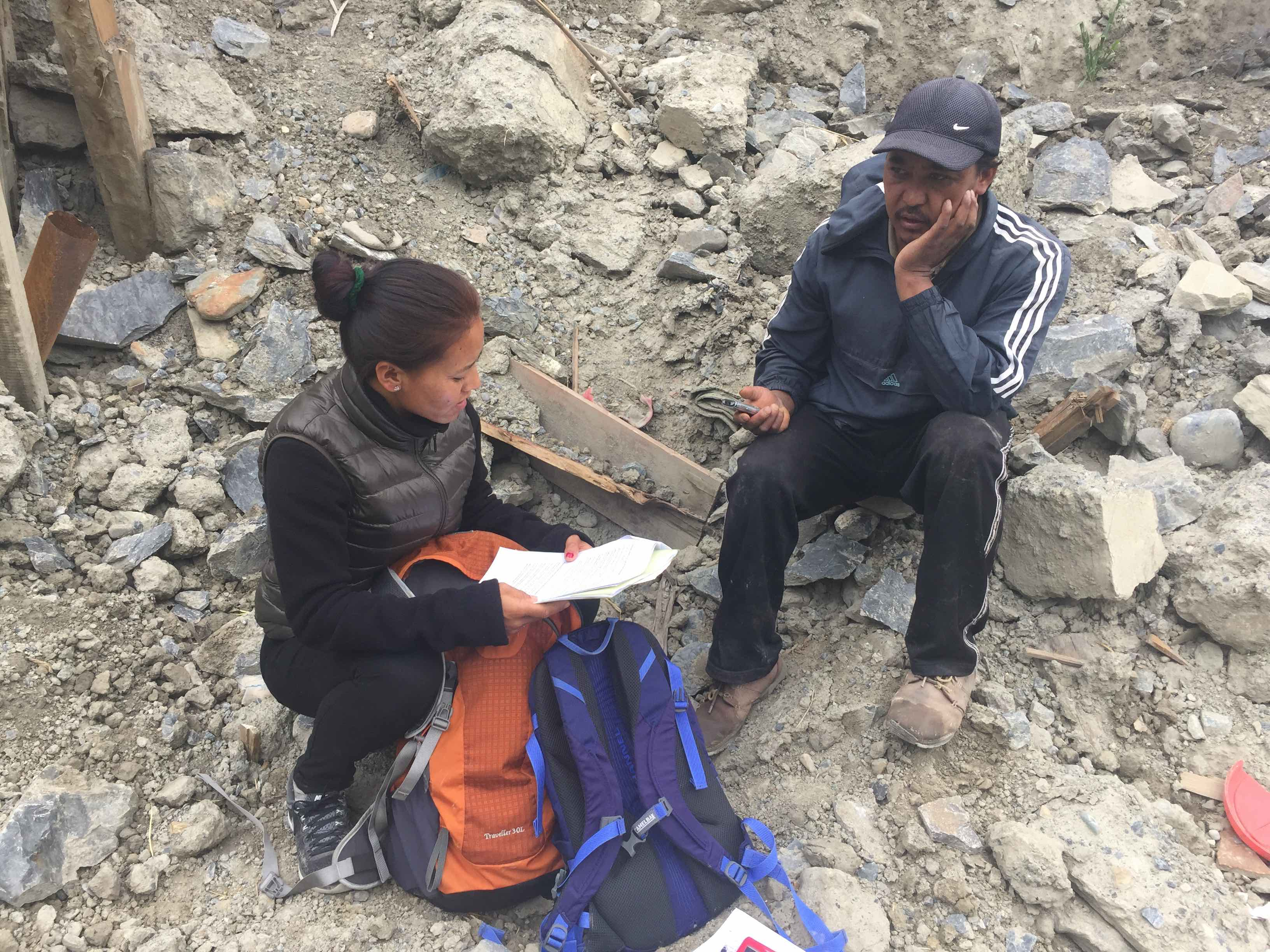 a researcher interviews a quake survivor in Nepal