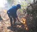 Scientist advancing  a fire line in an experimental fire plot in Mato Grosso, Brazil.