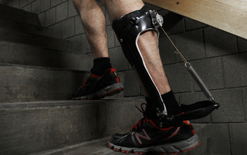 man climbing stairs with a passive-elastic ankle exoskeleton attached