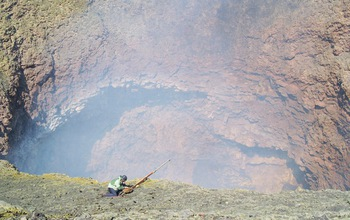 Geologist Jeff Johnson working in the inner crater of Villarrica, an active volcano in Chile.