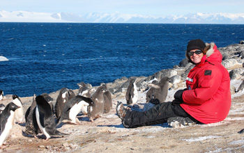 Jean Pennycook with group of Ad�lie penguins on the beach