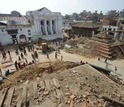 People and collapsed buildings in Durbar Square in Kathmandu, after the quake.