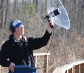 Biologist Kyle Horton with equipment used to record bird songs
