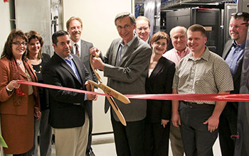 Photo of Director Charlie McMilan cutting the ribbon at Research Park in Los Alamos, New Mexico.