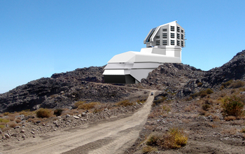 A photograph and a rendering mix, showing a view of the LSST's exterior building.