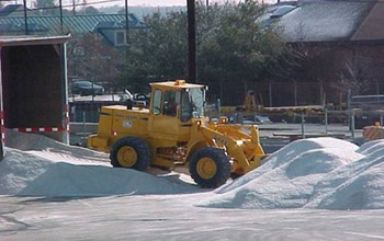 A Maryland State Highway Administration loader moves salt stored for use in winter.