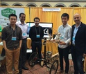 Researchers and students from MIT showcase a model of a smart, autonomous tricycle