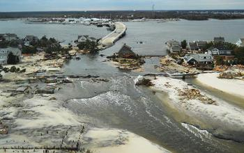 Image showing coastal region with colapsed highways and houses demaged by hurricane Sandy