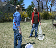 Two female scientists holding nets to capture bees.