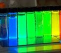 tubes with nanoscale crystals that emit light at different wavelengths, creating brillant colors.