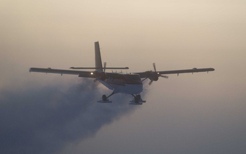 A Twin Otter flying out of the South Pole on a previous medical flight.