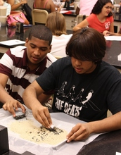 high-school students analyzing ore