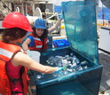 Researchers place sampling bottles in a container that mimicks the sea's light and temperature.