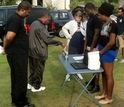 SCSU PAARE faculty and students talking with the public at a community outreach project