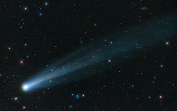 photo of comet Ison in the sky through a telescope
