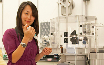 Scientist Pei-I Ku prepares a sample for a digital microscope used in the AIDS virus research.