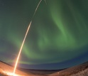 a rocket being launched into the northern lights