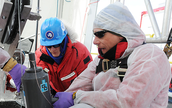Brent C. Christner and Alex Michaud retrieve the first water sample from Lake Whillans.