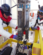Scientists recovering an instrument from subglacial Lake Whillans.