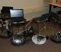 Four of the co-robots charge their batteries in their garage