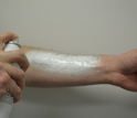Arm with spray-on foam