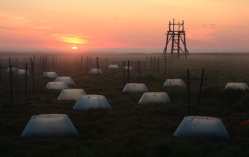 Environmental chambers in early morning light in the Yukon-Kuskokwim Delta in western Alaska.