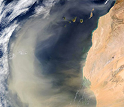 A massive dust plume over the Atlantic Ocean, caused by a dust storm in the Sahara Desert.