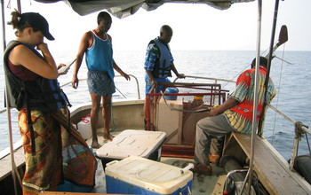 Four researchers on a boat on Lake Tanganyika