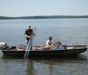Two scientists in a boat take water samples from Trout Lake in northern Wisconsin.
