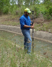 2017 Fellow Felix Santiago-Collazo conducts research by water