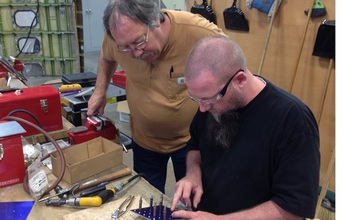Instructor working with a student at a technology center