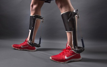 men's legs with a passive-elastic ankle exoskeleton attached
