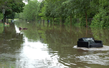 Beau A River  And Furniture  Ran Through It: Floods In Cedar Rapids, Iowa,  Carried Belongings With Them.