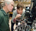 Scientists Rob Olson and Heidi Sosik work on the FlowCytobot automated submersible plankton sensor.