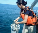 Researcher Kristen Hunter-Cevera uses low-tech bucket-sampling to collect seawater for analysis.