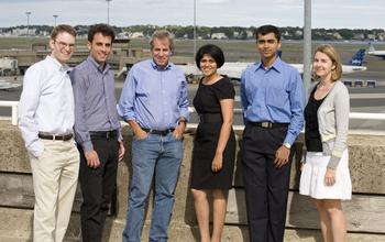 team of 6 MIT scientists standing at the airport