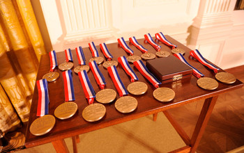 national science medals on a table